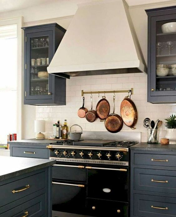 make a neutral backsplash more eye-catchy with a rail and vintage pots and frying pans
