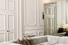 03 molded walls, ceiling and a glam chandelier combine with contemporary furniture and other touches