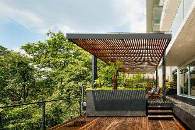 Here's a comfy pergola that connects the spaces