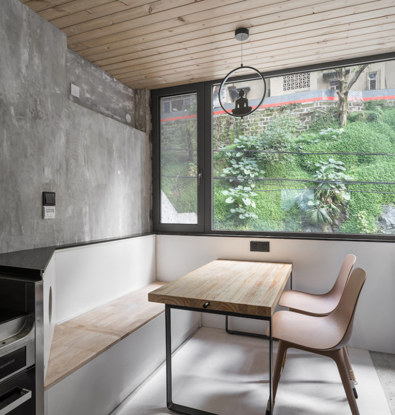 The dining space features a storage bench and cool views
