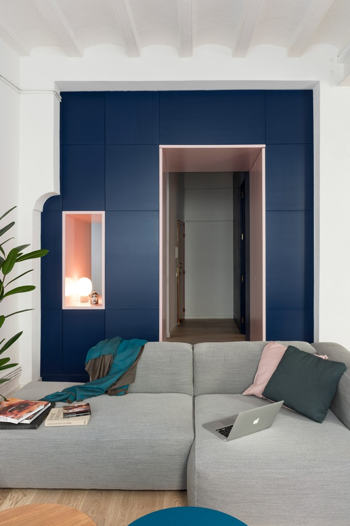 The storage is hidden behind these navy panels, it's sleek and very practical
