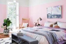 04 a colorful bedroom with watercolor bedding, a wicker pendant lamp and a vintage storage bench