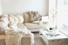 04 a cozy rustic space with a glam feel and a large sectional creamy sofa that defines the space