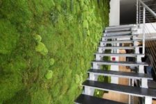 04 a fresh moss wall next to the staircase creates a feel of an indoor garden