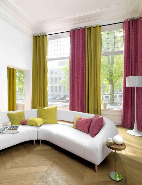 colorful folded draperies in neon green and pink to add color to a neutral room