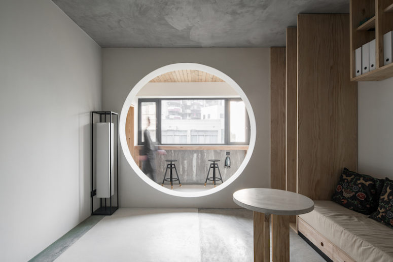 A circular opening adds to the design and brings more light in than a regular glass door