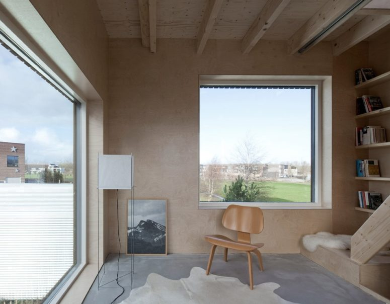 Large windows provide natural light and ventilation and create a feeling of spaciousness