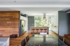 05 The indoor spaces features as open layouts as possible and such wood, marble, stone and plywood in decor