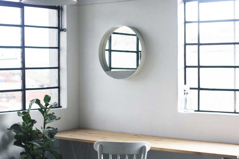 The piece is available in black and white to fit different interiors, and cocnrete is very durable