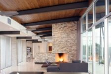 05 a modern rich-colored wooden ceiling with black metal ceiling beams for a minimalist look