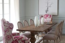 05 a vintage rustic dining room is spruced up with pink floral upholstery wingback chairs
