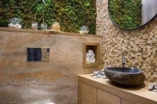 05 an eco-friendly bathroom with a moss wall and some wood and stone in decor