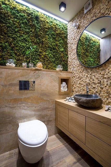 an eco friendly bathroom with a moss wall and some wood and stone in decor