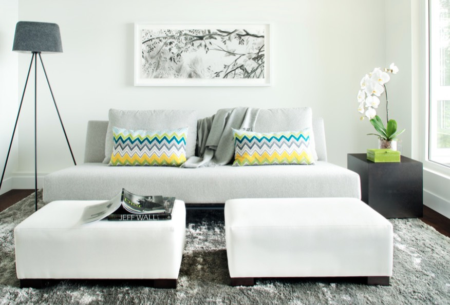 large ottomans in a luxurious creamy shade make the space bold and chic
