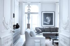 05 molding on the walls, doors and ceiling is completed with modern art and laconic furniture