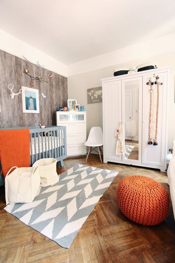some orange accents finish the look and add a cheerful feel to the space