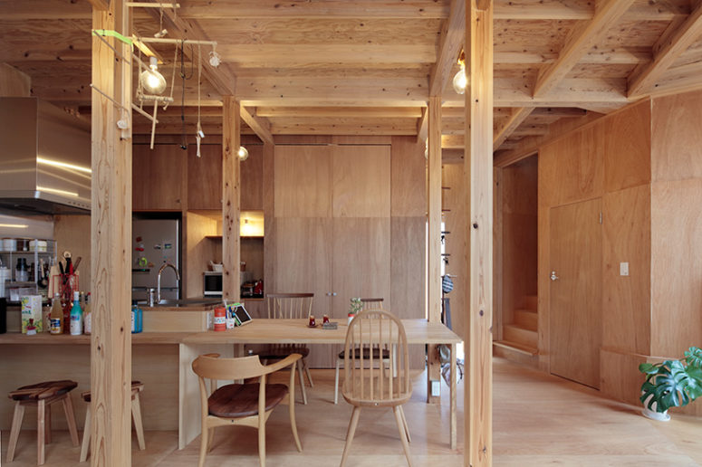Everything is clad with wood, there are bulbs instead of lamps and the furniture is wooden, too