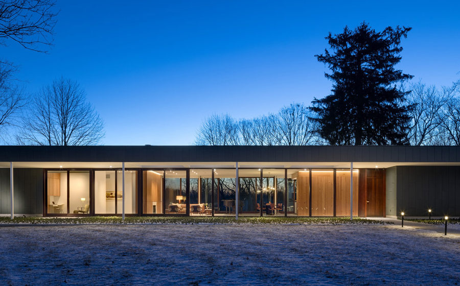 The home is long and low, it's extensively glazed to bring much light inside