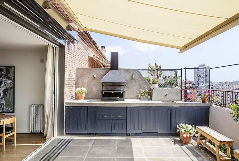 The terrace features a kitchen with a grill and much storage in the cabinets