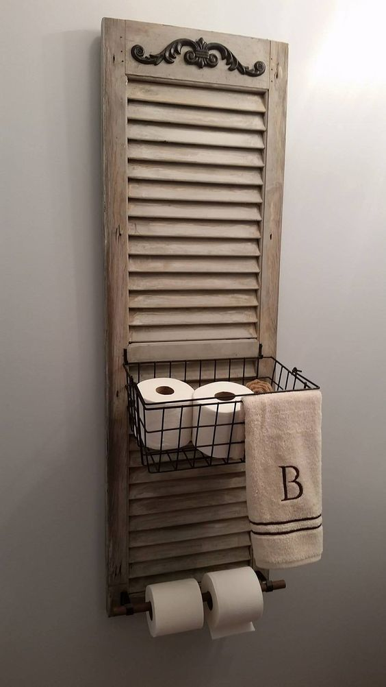 a bathroom shelf made of an old shutter and a metal basket is an easy DIY project