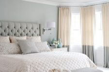 06 a serene bedroom in blush and grey, with a glam chandelier and a refined bench at the foot