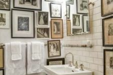 hanging gallery wall in a bathroom