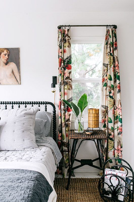 vibrant floral curtains add a vivacious touch to the bedroom and make it more eye-catchy