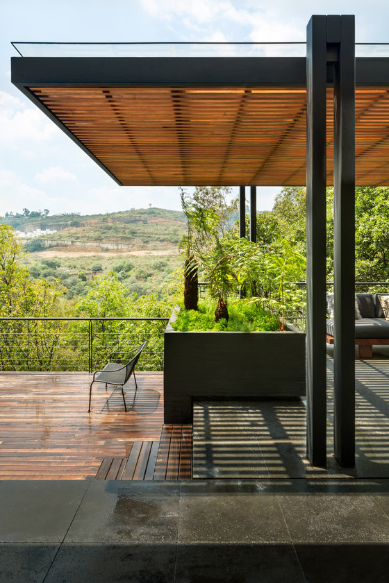 Lush private gardens and views create a feeling of living somewhere in a forest and not in the city