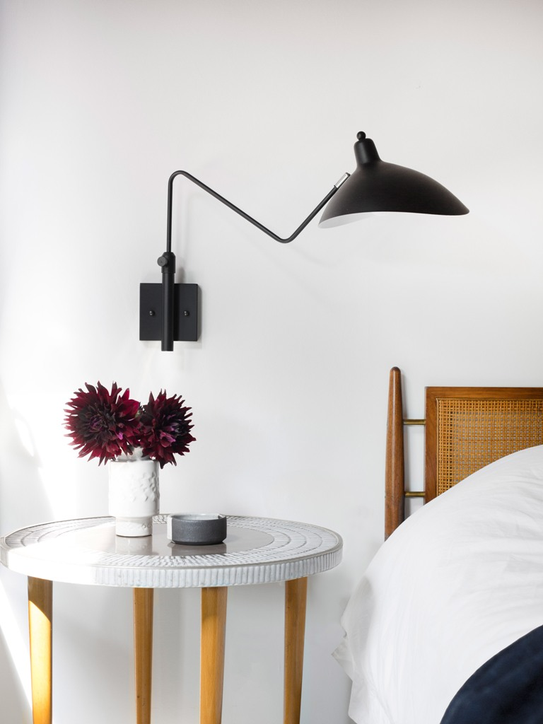 Sconces, nightstands and all the accessories are perfectly styled to fit the room