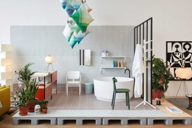 The bathroom is open, with colorful pillows installation over it and modern appliances