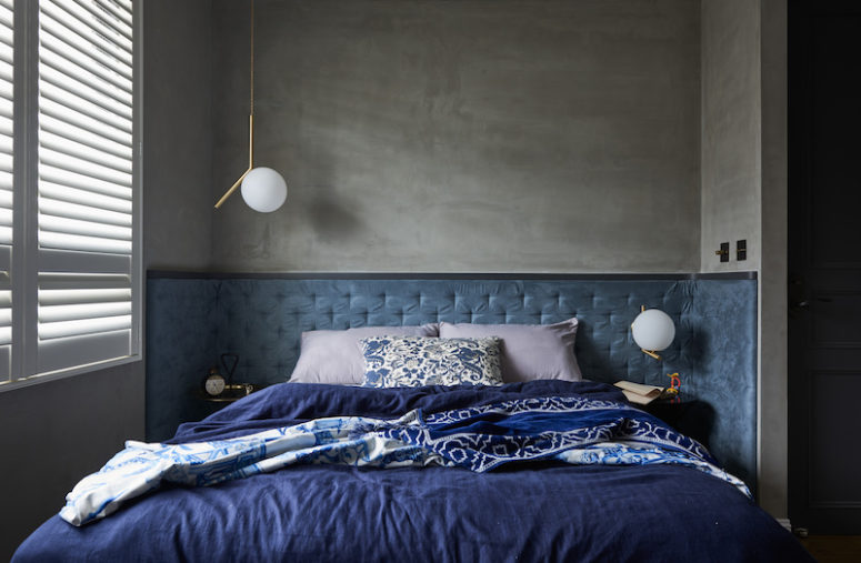 The master bedroom is done in the shades of blue and grey and is small and cozy