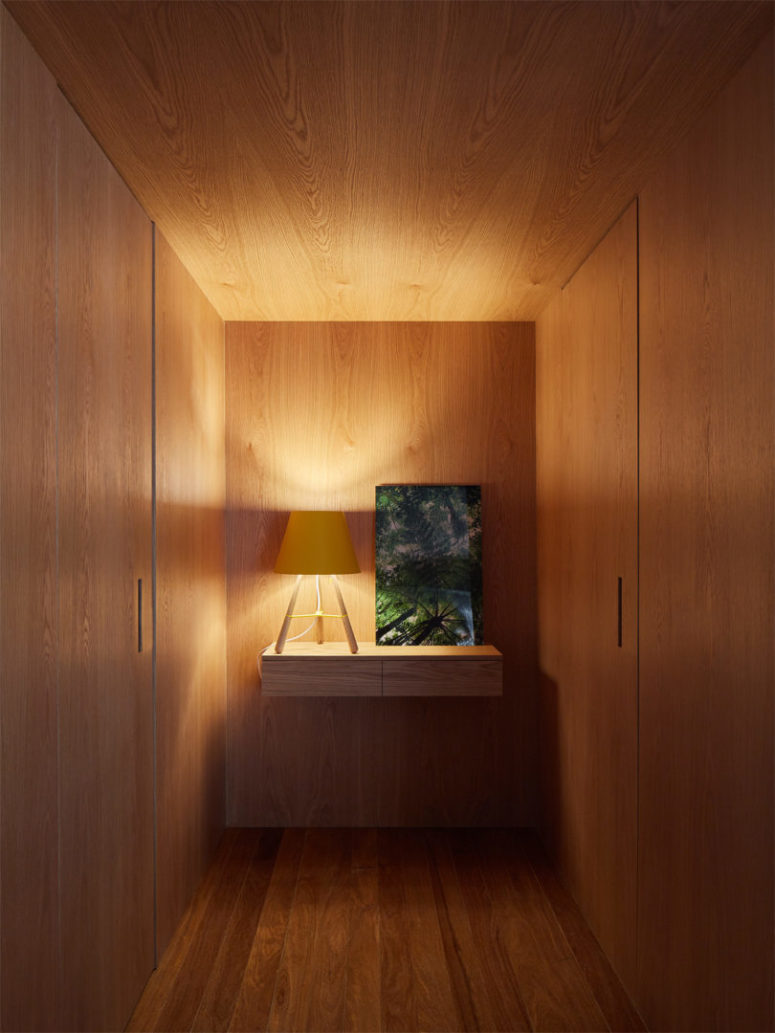This is a small entryway completely clad in wood, it features doors to the powder room and exit