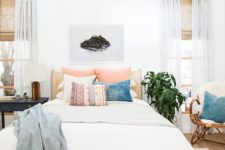 07 a boho bedroom with a wooden bed, muted colored textiles and wicker furniture