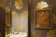 07 a refined space with a framed artwork, gilded touches and a glam chandelier looks wow