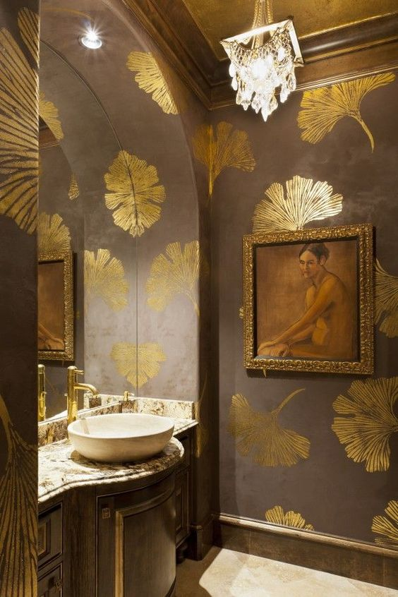 a refined space with a framed artwork, gilded touches and a glam chandelier looks wow