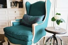 07 a vintage dark green wingback with light-colored wooden framing is a gorgeous statement piece