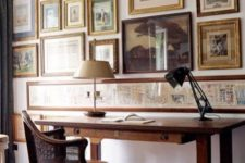 07 a vintage home office with a gallery wall that takes the whole wall, mismatched frames create a catchy look