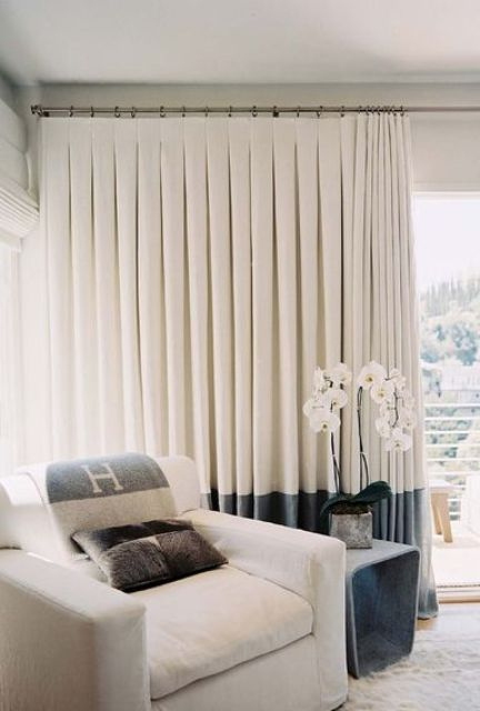 inverted pleat curtains with color blocking are sure to add visual interest to the space