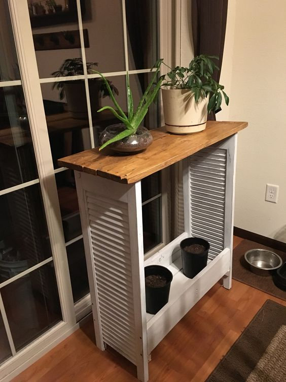 repurposed shutters and pallet wood into a plant shelf or table is a cute idea to add a character to the space