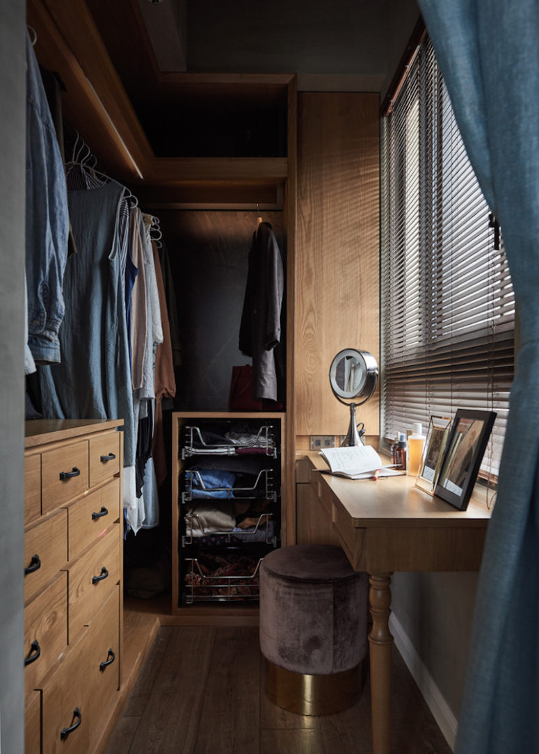 The walk-in closet is small yet functional due to the smart storage solutions