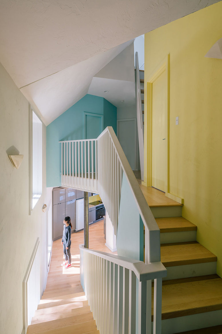 There are various statement walls - turquoise, yellow ones, and windows everywhere create a play of light