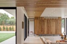 living room with a wood wall