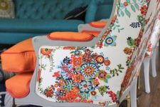 08 a vintage wingback armchair is given a bold look with floral upholstery on the back and orange on the front