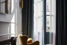 08 navy velvet curtains add a refined touch to the space and hide the space from sunlight the best way possible