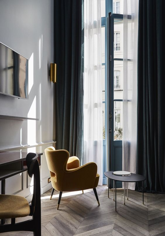 Navy Velvet Curtains Add A Refined Touch To The Space And Hide From Sunlight