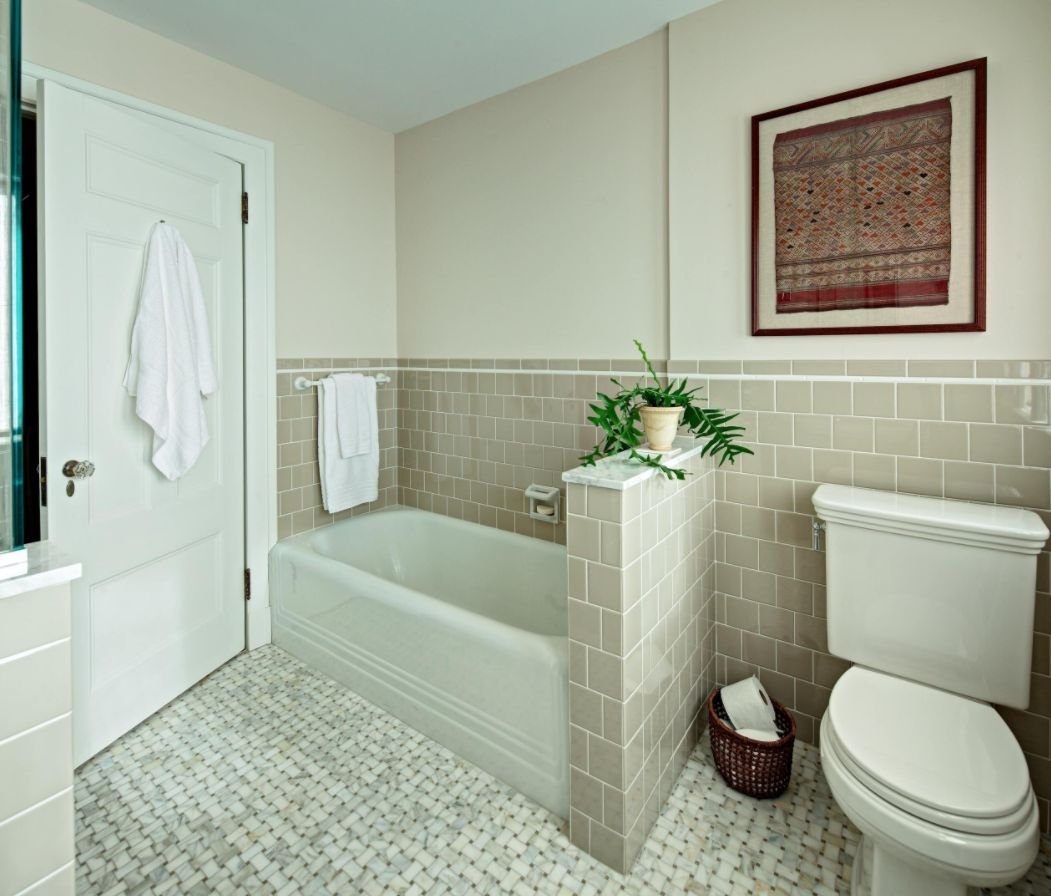 separate the bathtub from the toilet zone to make the space more stylish and comfortable