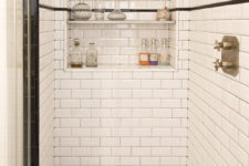 09 A built-in shower shelf with wine storage, yes, please