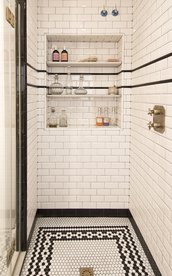 A built-in shower shelf with wine storage, yes, please