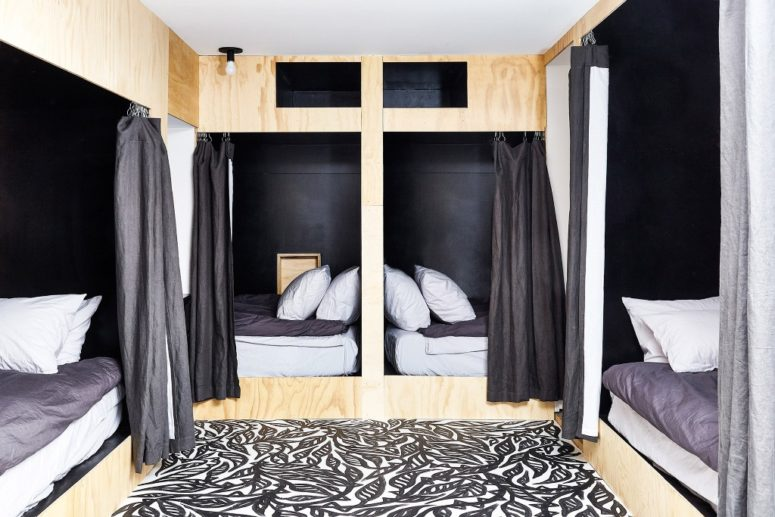 The guest bedroom is done in a creative way, there are four beds with curtains to achieve some privacy
