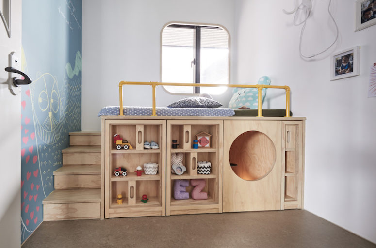 The kids' room is done with a large unit comprising storage, a play space and a bed on top